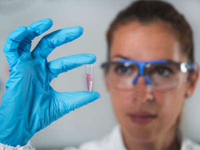 Female Scientist With Vial, Credit: Stock Photography