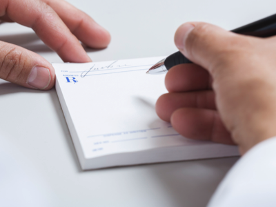 Doctor writing a prescription, Credit: Stock Photography