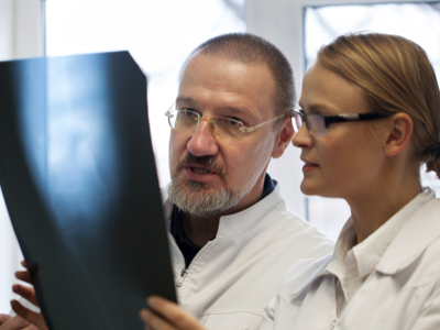 Doctors reviewing an Xray, Credit: Stock Photography
