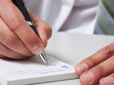 Doctor writing prescription, Credit: Stock Photography