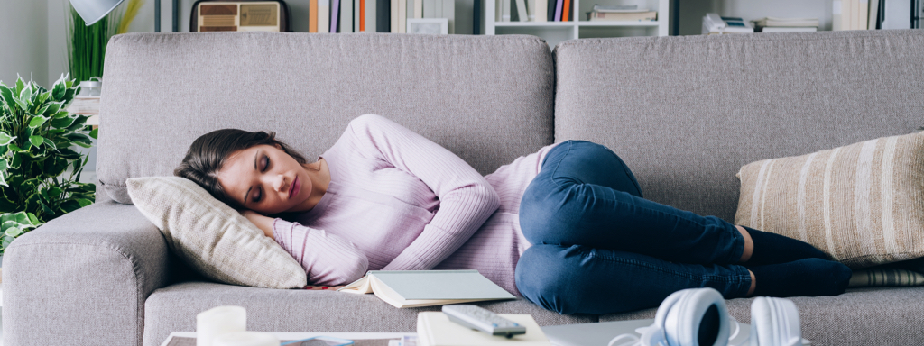 Woman Sleeping on Couch, Credit: Stock Photography