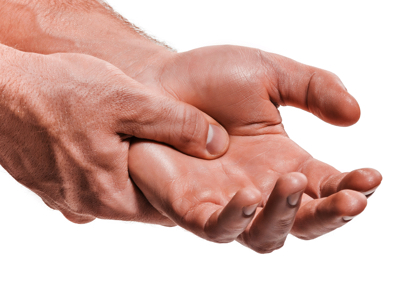 Male Hand Pain. Credit: Stock Photography