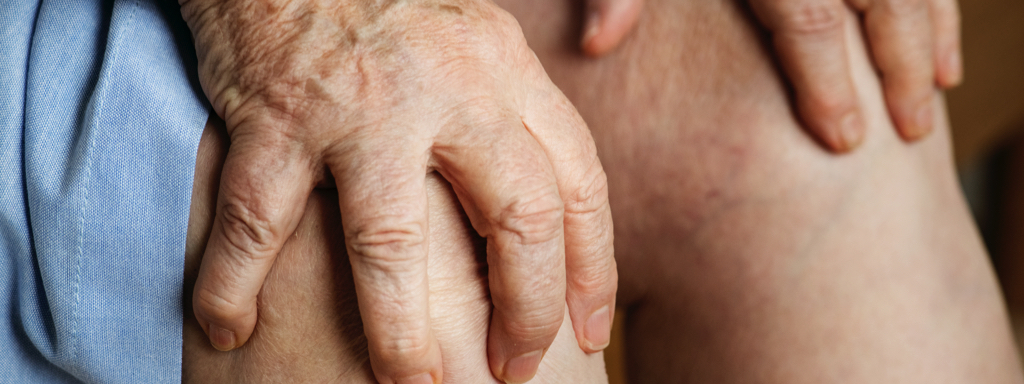 Elderly woman suffering knee pain, Credit: Stock Photography