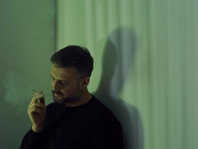 Man Smoking Cigarette, Credit: Stock Photography