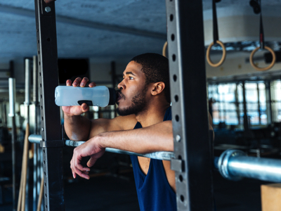 Man Drinks Water At The Gym, Credit: Stock Photography