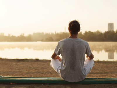 Man Meditating By The Water, Credit: Stock Photography