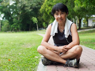 Senior Woman Sitting Cross Legged, Credit: Stock Photography