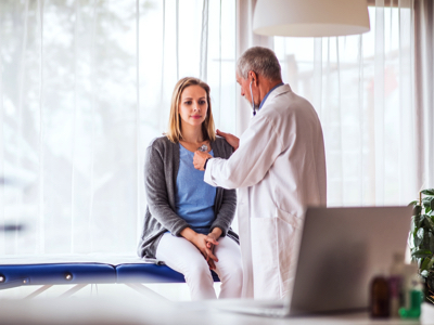 Doctor Evaluates Female Patient, Credit: Stock Photography