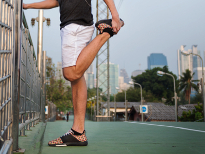 Male Runner Stretching, Credit: Stock Photography