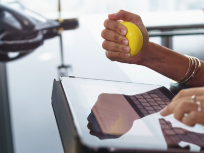 Squeezing A Stress Ball, Credit: Stock Photography
