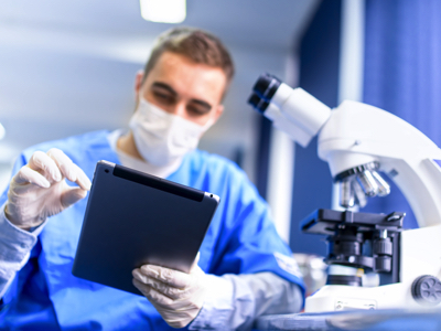 Scientist With Notepad, Credit: Stock Photography