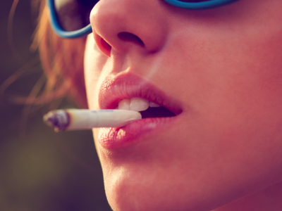 Woman Smoking A Joint, Credit: Stock Photography