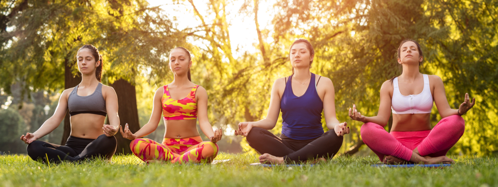 Women Meditating In The Park, Credit: Stock Photography