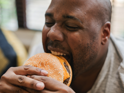 Man Eats Fast Food, Credit: Stock Photography