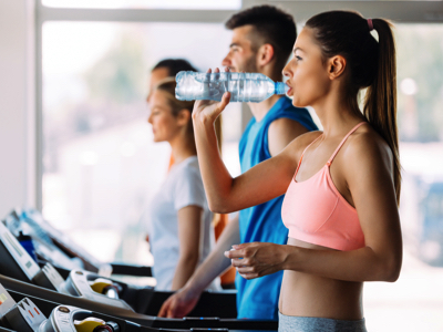 Fit Woman Drinking Water, Credit: Stock Photography