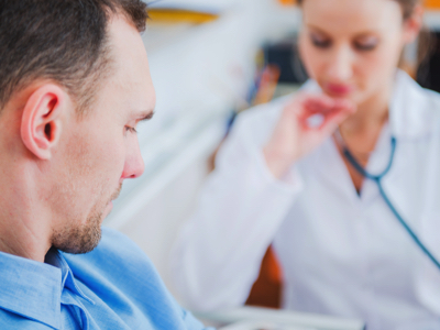 Doctor With Patient, Credit: Stock Photography