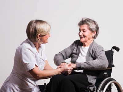 Wheelchair Patient With Doctor, Credit: Stock Photography