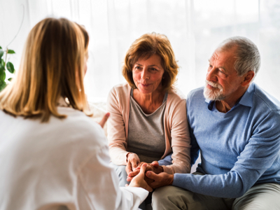 Senior Couple Talking to a Doctor, Credit: Stock Photography