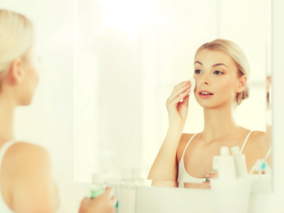 Woman Applies Real Revolution Real Serum for Face, Credit: Stock Photography