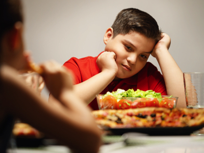 Child Disinterested In Salad, Credit: Stock Photography
