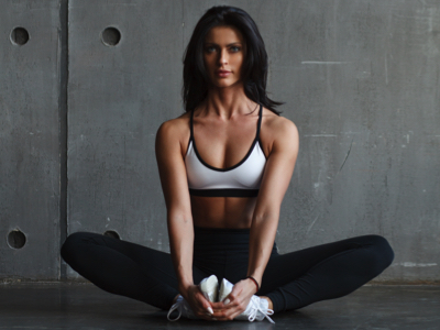 Woman Doing Butterfly Stretch, Credit: Stock Photography
