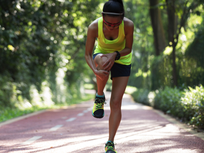 Runner with Cramped Knee, Credit: Stock Photography