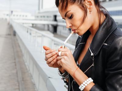 Woman Smoking Cigarette, Credit: Stock Photography