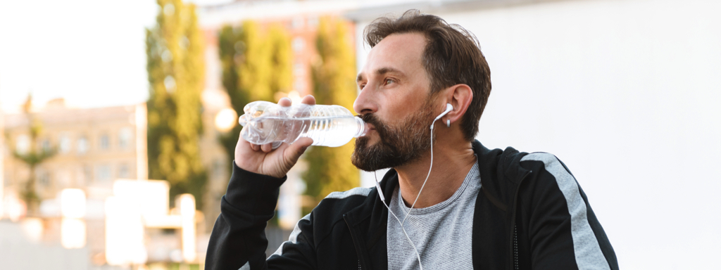 Athletic Man Drinking Water, Credit: Stock Photography